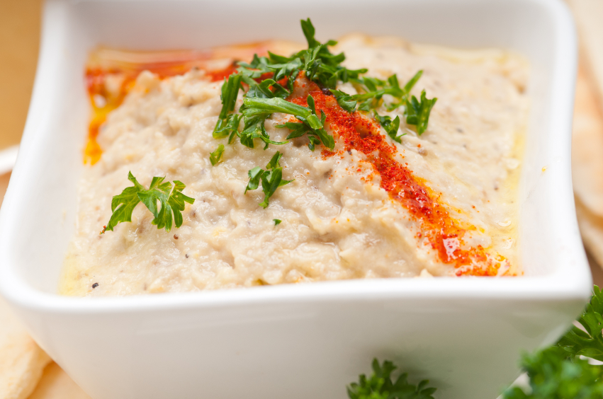 White bean dip in a square shaped bowl