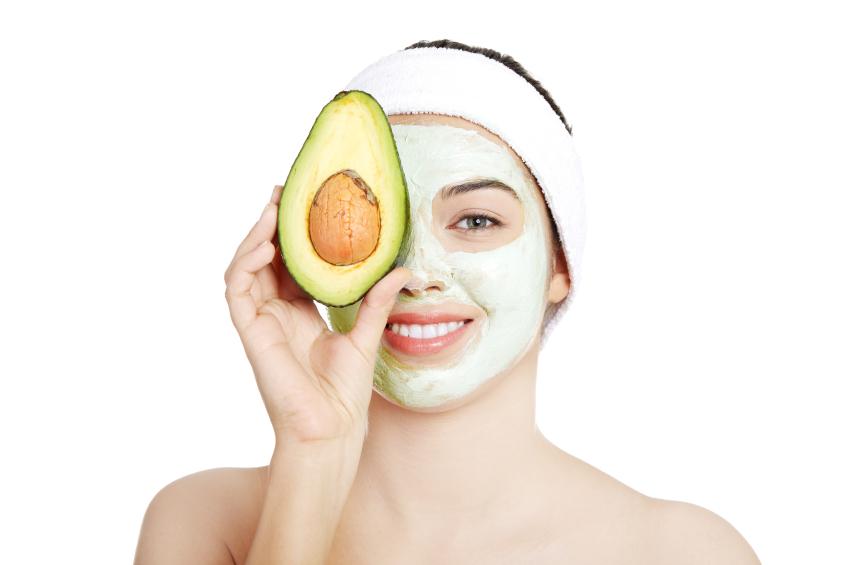 Woman wearing an avocado face mask