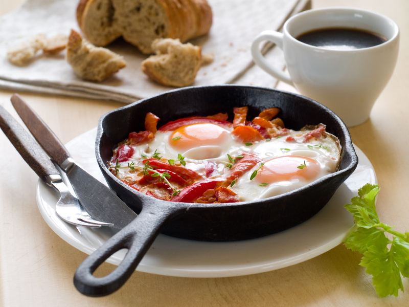 shakshuka with eggs, tomatoes, and peppers