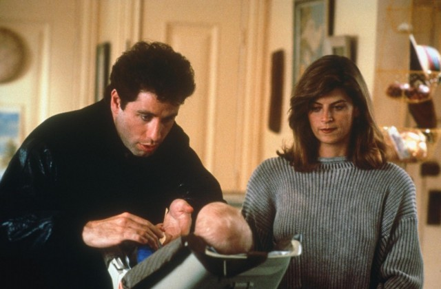 John Travolta and Kirstie Alley lean over a baby in Look Who's Talking