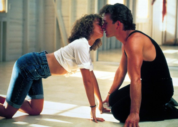 Patrick Swayze leans in to kiss Jennifer Gray in an iconic scene from Dirty Dancing