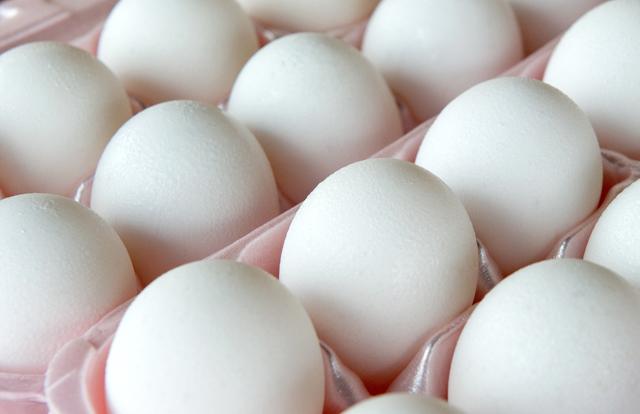 Eggs sit in an egg carton