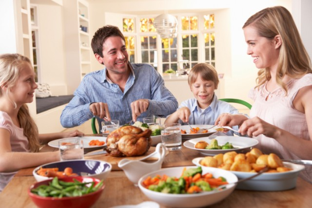 young family eating dinner at kitchen table