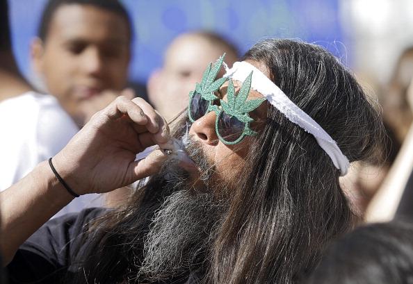 Man smoking marijuana at a festival