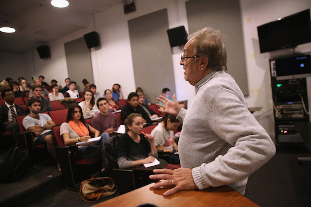 A college professor speaks to his class