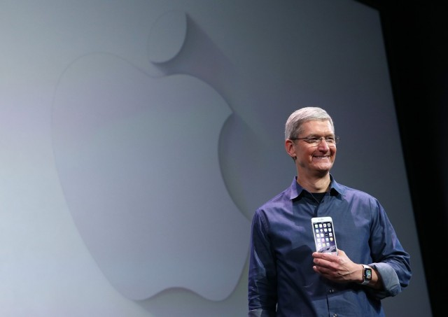 Apple CEO Tim Cook shows off the new iPhone 6 and the Apple Watch during an Apple special event