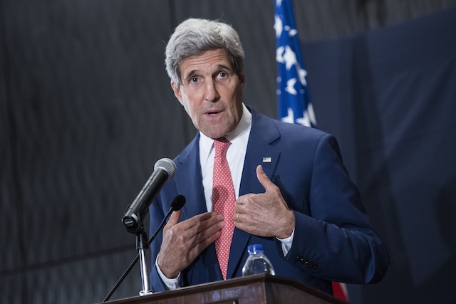 John Kerry speaks at a conference