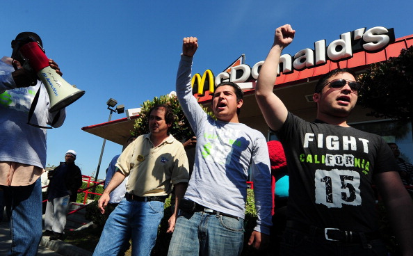 workers protest for higher minimum wage