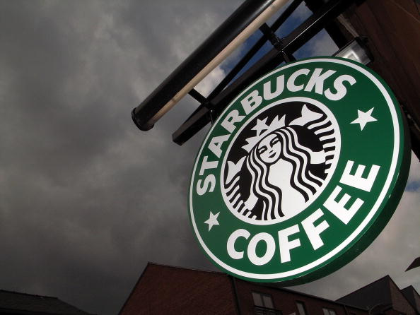 The Starbucks logo hangs outside one of the company's cafe