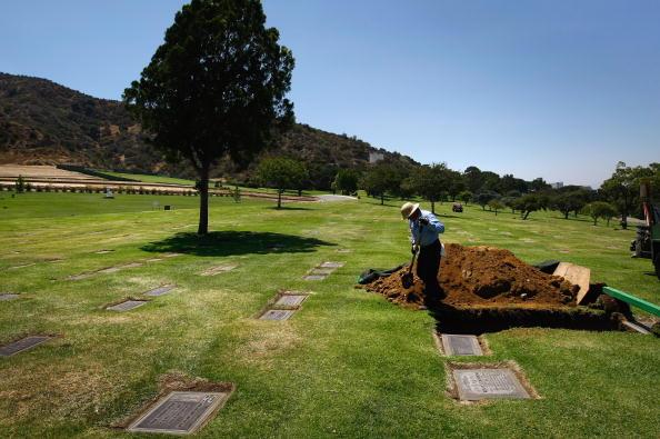 man digging up grave