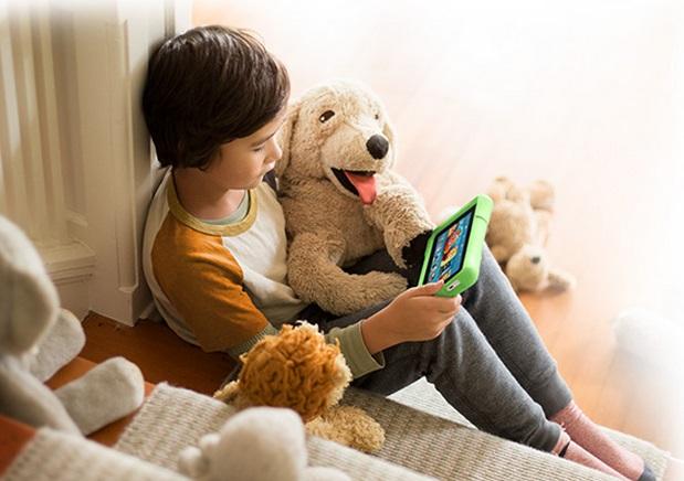 kid reading to stuffed dog