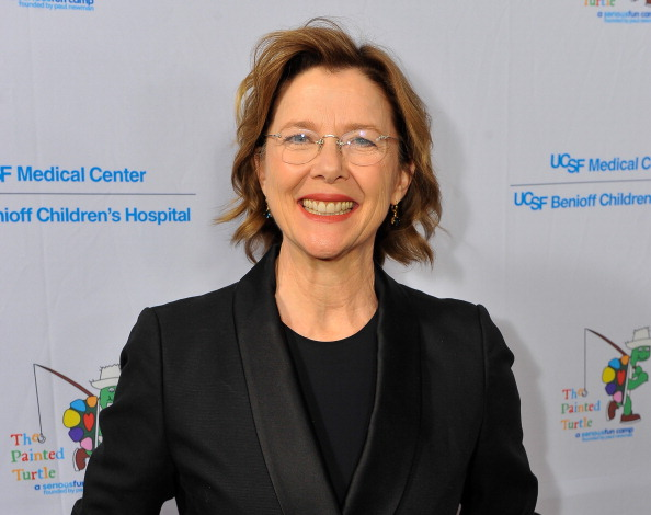Annette Bening smilles at the camera while attending an event