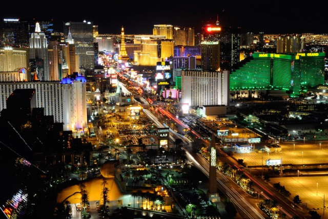 A view of the Las Vegas Strip seen before Earth Hour from the House of Blues Foundation Room inside the Mandalay Bay Resort & Casino March 26, 2011 in Las Vegas, Nevada. Hotel-casinos in Las Vegas turned off marquees and non-essential exterior lighting to participate in Earth Hour, a global initiative by the World Wildlife Fund to focus attention on the threat of climate change. (Photo by Ethan Miller/Getty Images)