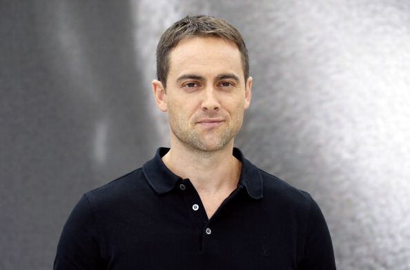 Stuart Townsend stares directly into the camera
