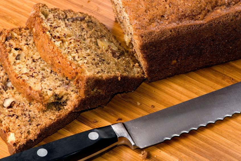 loaf of fresh banana bread being sliced