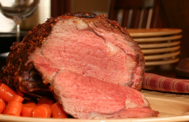 Large roast beef with carrots