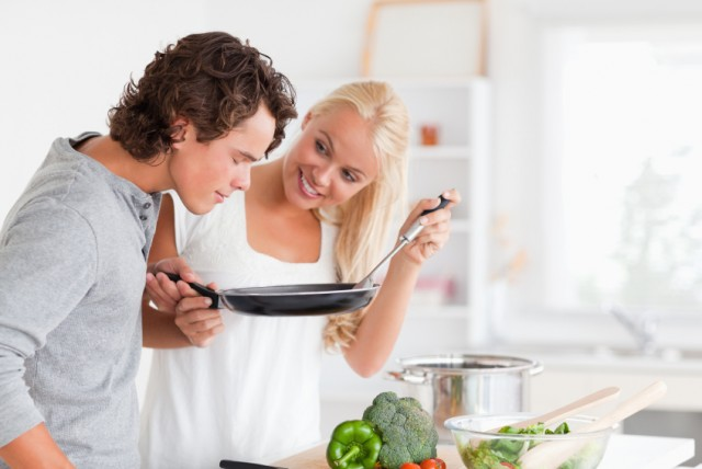 Couple learning to cook something new