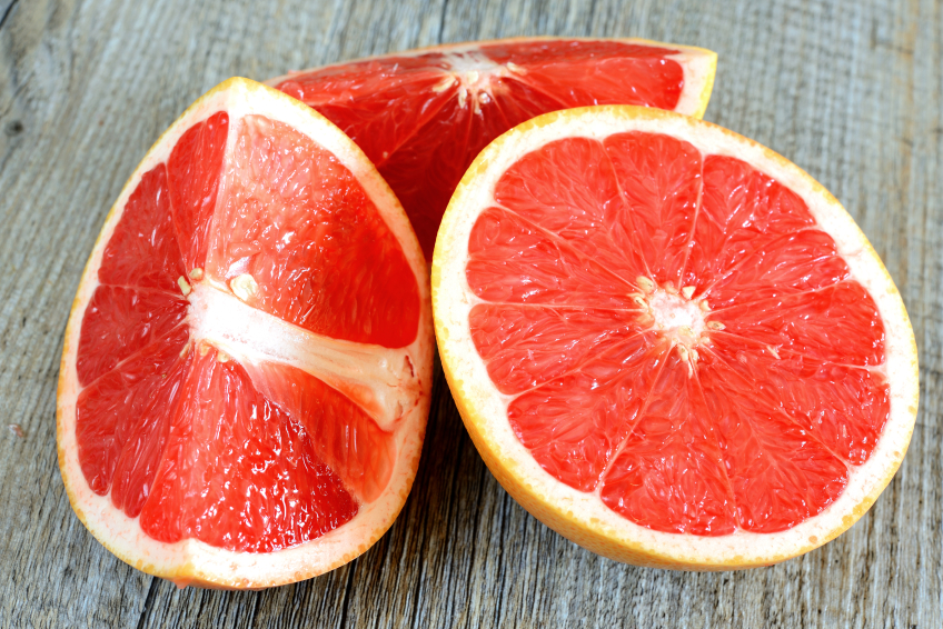 Grapefruit segments on a wooden table