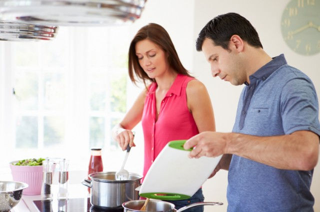 Man and woman cook dinner together