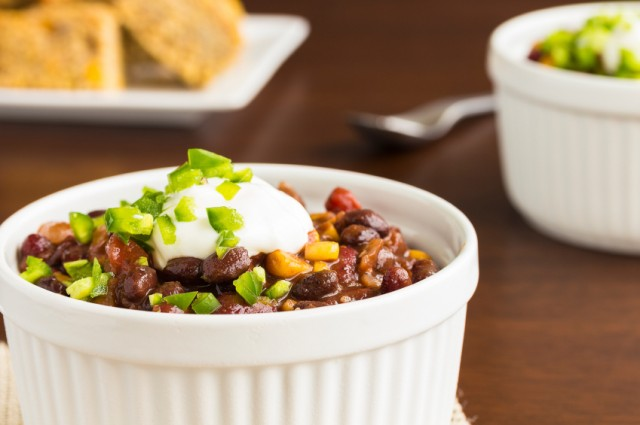 vegetarian chili topped with scallions and sour cream