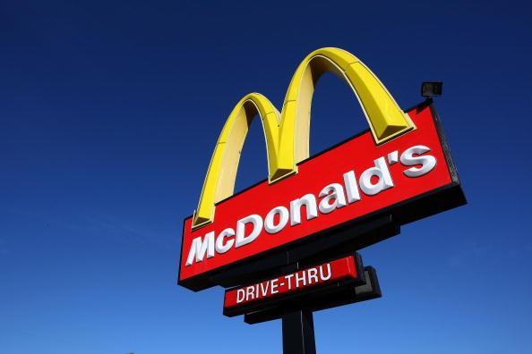 McDonald's sign against clear blue sky