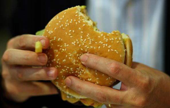 Person eating a Burger King hamburger