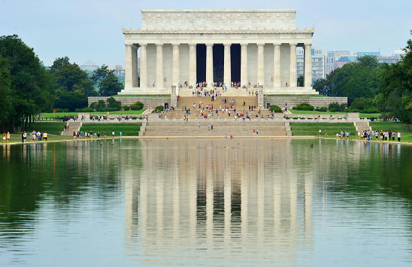Tourists at the Lincoln Memorial on August 3, 2010 in Washington, DC.   Photo by Karen Bleier/AFP/Getty Images