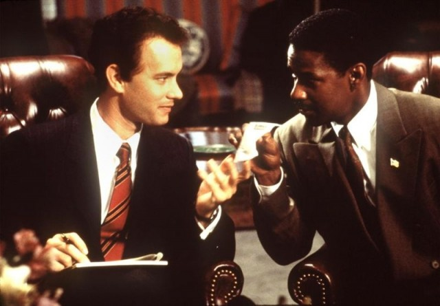 Tom Hanks and Denzel Washington talk while sitting in leather armchairs