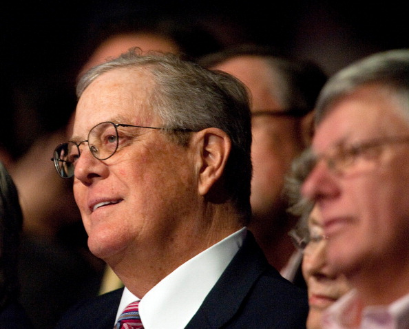 """Billionaire David Koch, chairman of the board of the conservative Americans for Prosperity (AFP) advocacy group, attends a """"Cut Spending Now"""" rally at AFP's """"Defending the American Dream Summit"""" in Washington on November 5, 2011.  (Photo by Nicholas Kamm/AFP/Getty Images)"""