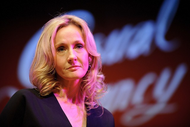 J.K Rowling on stage looking serious.