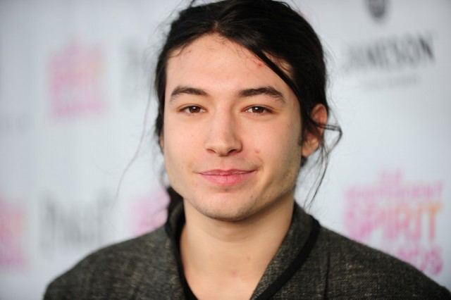 Ezra Miller smiling and staring straight ahead.