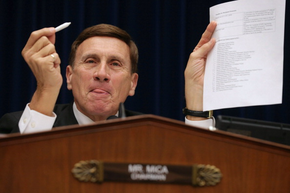 A D.C. policymaker holds up a joint during a hearing