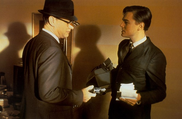 Tom Hanks talks to Leonardo DiCaprio in Catch Me If You Can