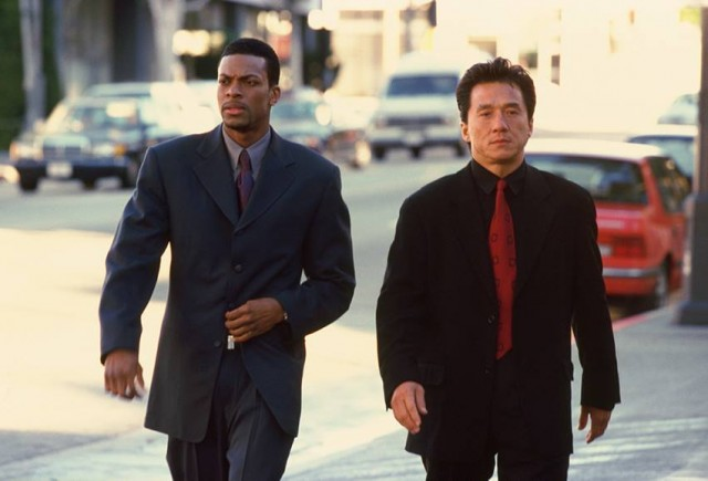 Chris Tucker and Jackie Chan walking down a street in 'Rush Hour'.