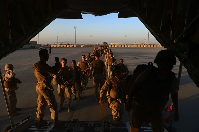 Marines load onto a plane