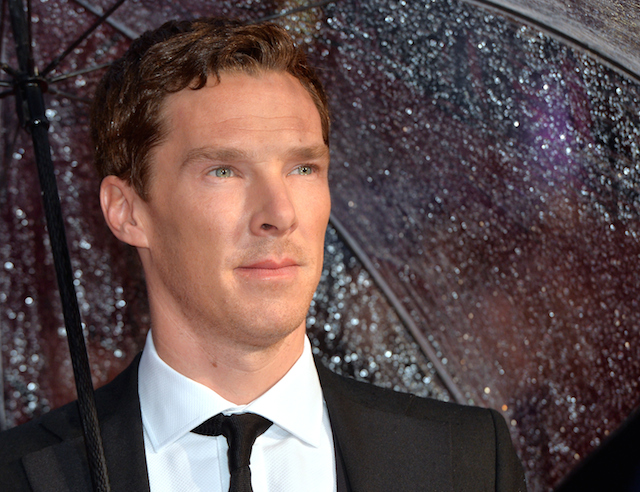 Benedict Cumberbatch is posing for a picture on the red carpet.