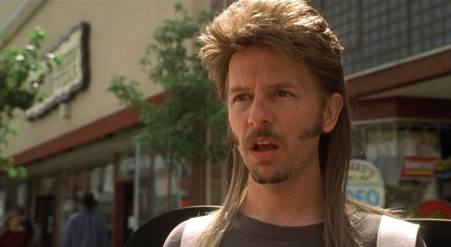 David Spade is in a mullet and side burns as Joe Dirt.