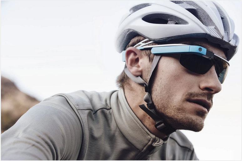 A man wears Google Glass on a bike