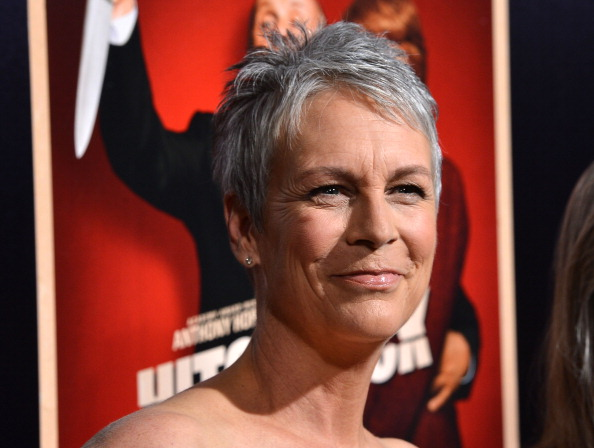 This is a closeup of Jamie Lee Curtis smiling on the red carpet.
