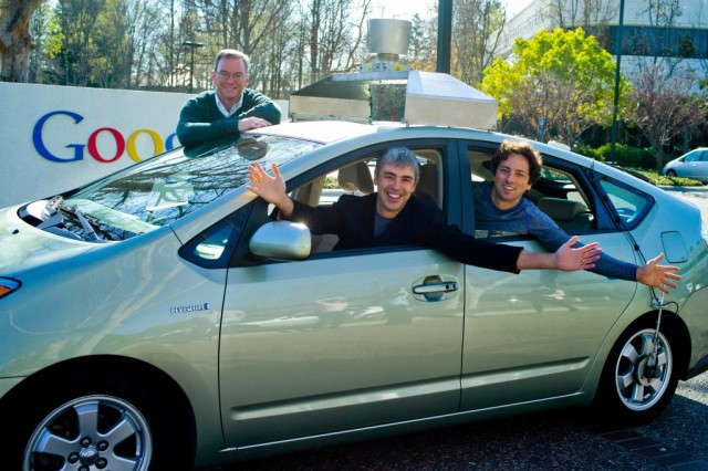 Eric Schmidt, Larry Page, and Sergey Brin with a self-driving car in January 2011