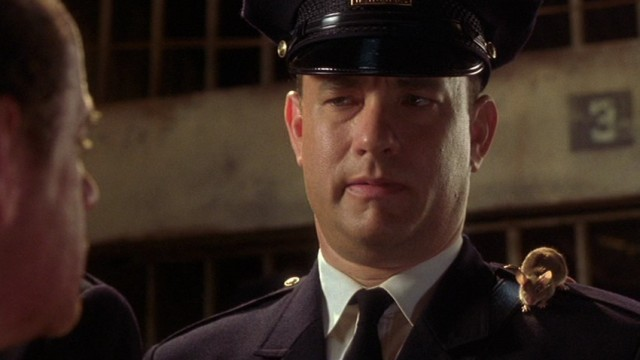 Tom Hanks wears a guard's hat and uniform in The Green Mile