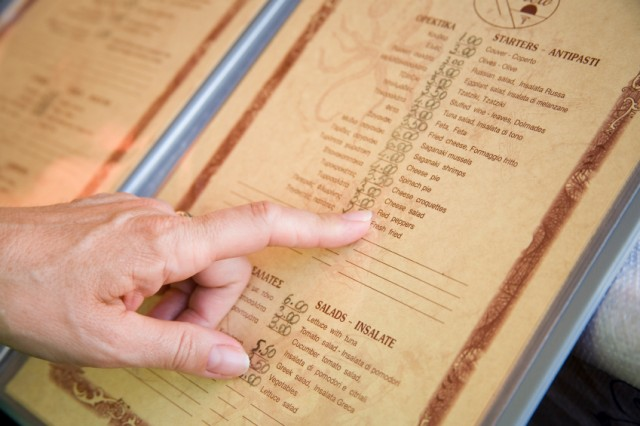 Man pointing to an item on a restaurant menu