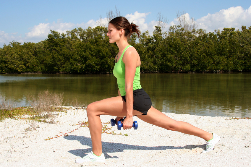 Woman outside doing lunges