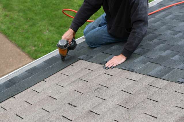 A roofer roofing