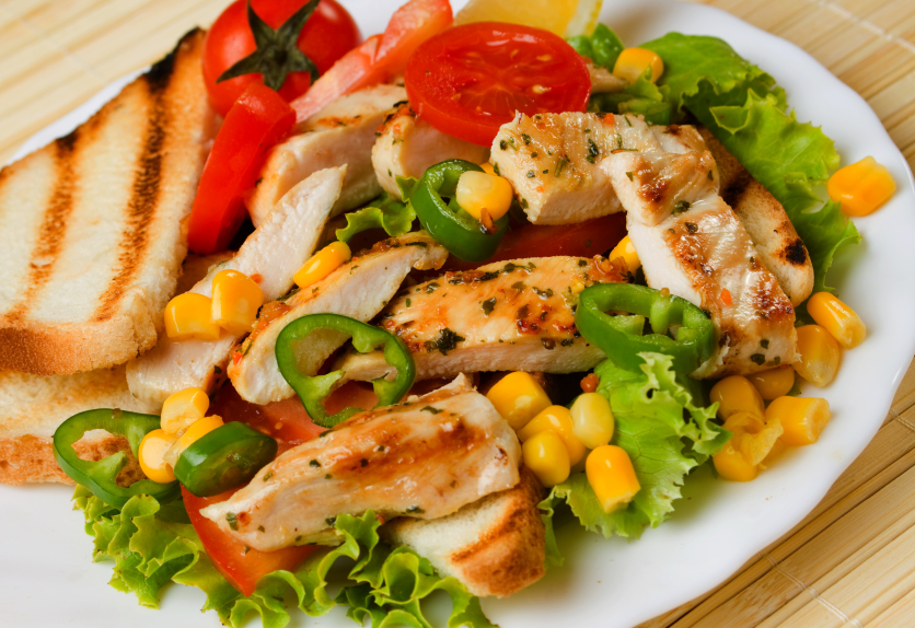 Grilled chicken breast, vegetables, tomato, salad