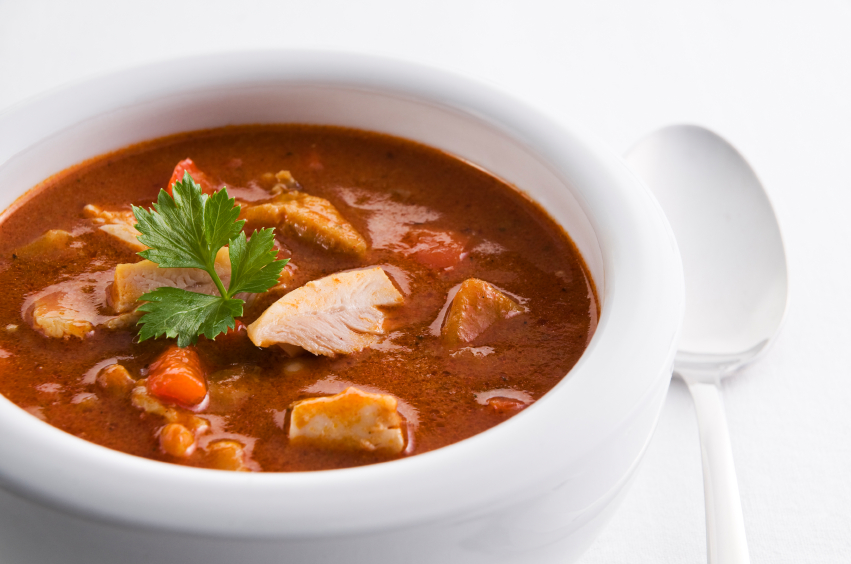 Soup with chicken, veggies, and herbs