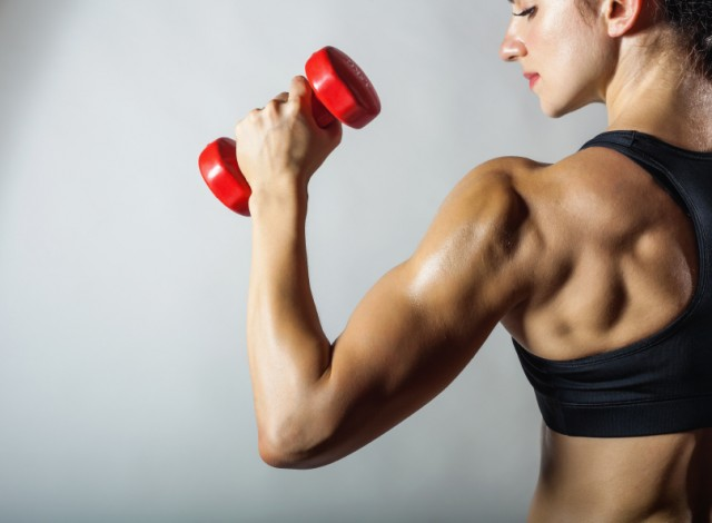 Woman doing arm workout for anti aging