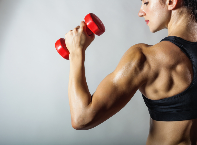woman holding a dumbbell