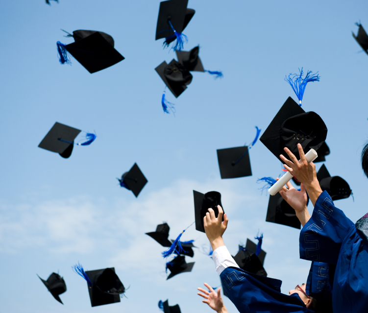 College Graduation, caps flying in air