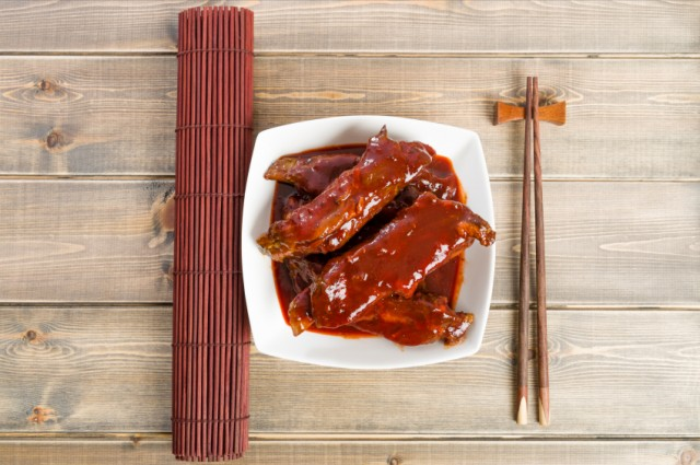 ribs smothered in barbecue sauce on a plate